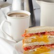 Sandwich with fried egg and tomatoes and cup of coffee — Stock Photo #71249607