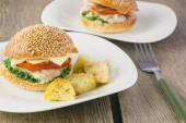 Cheeseburger with turkey and potato wedges — Stock Photo