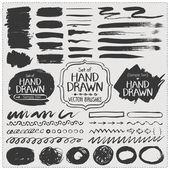 Set of hand drawn vector brushes. Grunge brush strokes. — Stock vektor
