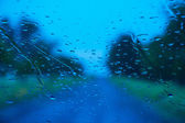 Road seen through water drops on the car windshield — ストック写真