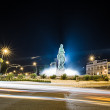Night view of a statue at crossroads with buildings — Stock Photo #66083795