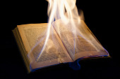 Visible text book open on fire — Stock Photo