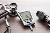 Blood glucose meter to check the blood sugar level — Stock Photo