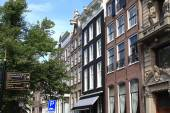Amsterdam with architecture and city signs. — Stock Photo