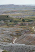 Badlands Formation and Creek — Stock Photo