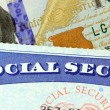 Social security card and US currency one hundred dollar bill — Stock Photo #66031767