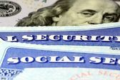 Social security card and US currency one hundred dollar bill — Stock Photo