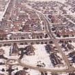 Aerial of homes in a snow covered suburban neighborhood — Stock Video #66030617
