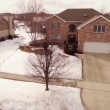 Aerial of homes in a snow covered suburban neighborhood — Stock Video #66313281