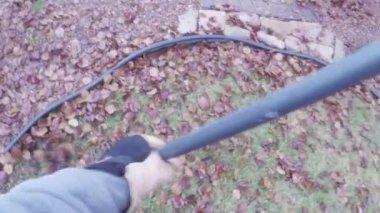 Yard work raking autumn leaves on lawn — Stock Video