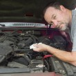 Mechanic Checking Oil Levels On A Older Vehicle — Stock Photo #72985059