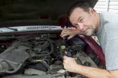 A Mechanis Pouring Brake Fluid Into A Master Cylinder On A Older — Stock Photo