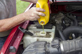 A Mechanic Adding Coolant To A Older Truck — Stock Photo