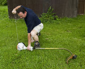 Man Starting A String Trimmer — Stock Photo