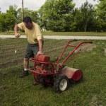 Organic Farmer Starting A Old Garden Tiller — Stock Photo #74020181