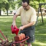 Putting Gas In A Old Garden Tiller — Stock Photo #74020191
