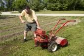 Organic Farmer Starting A Rear Tine Tiller — Stock Photo