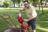 Put Gas In A Old Garden Tiller — Stock Photo