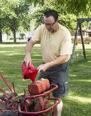 Putting Gas In A Old Garden Tiller — Foto Stock