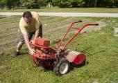 Gardener Trying To Start A Older Garden Tiller — Foto Stock
