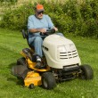 Older Gentleman Cutting Gas On Riding Lawnmower — Stock Photo #76317159