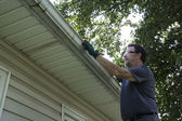 Cleaning Gutters Of Leaves And Sticks — Stock Photo