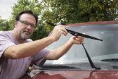 Mechanic Taking Worn Wiper Blade Off — Stock Photo