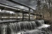 Wooden Walking Bridge Over Winter Waterfall — Stock Photo