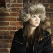 Girl Wearing Furry Winter Hat Brick Wall Background — Stock Photo #69639979