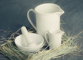 White porcelain set on a gray background — Fotografia Stock