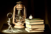 Still-life with books and kerosene lamp — Stock Photo