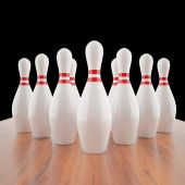 Illustration of bowling pins on a wooden floor. — Stock Photo