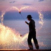 Fire show on the beach — Stock Photo