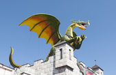 A dragon on a castle roof — Stock Photo