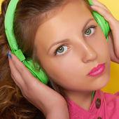Teen girl listening music on headphones — Stock Photo