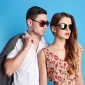 Fashion beautiful couple in sunglasses — Stock Photo