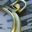 Time and Money. Gold Tone. Close up - Stock Image  — Zdjęcie stockowe #67067633