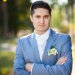 Portrait of handsome young man smartly dressed in blue suit — Stock Photo #66605677