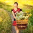 Close up Portrait of Happy Young Woman with with Basket full of — Stock Photo #71174837