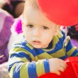 Close up portrait of cute little baby boy playing with toys — Stock Photo #73486655
