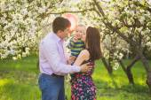 Portrait of happy family. father, mother, child hugging and kiss — Stock Photo