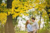 Happy couple hagging in autumn forest — Stock Photo