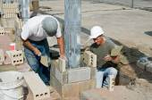 Bricklayers Installing Soldiers — Stock Photo
