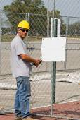 Worker Posting Blank Sign — Stock Photo