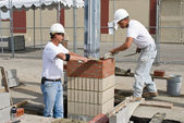 Two Bricklayers — Stock Photo