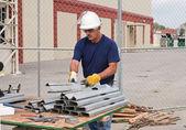Worker Stacking Metal Studs — Foto de Stock