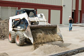 Bobcat Dumping Sand — Stock Photo