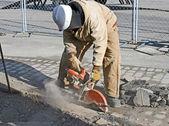 Worker Cutting Pavement — Stock Photo