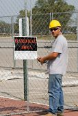 Worker Posting Sign — Stock Photo