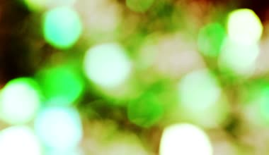 Shining light green blue grey gold  abstract bokeh background bokeh holiday ornaments bright spot defocused circle brilliant — Stock Video